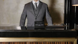 Concierge at desk.