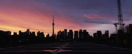 Photo of Toronto skyline at sunrise.